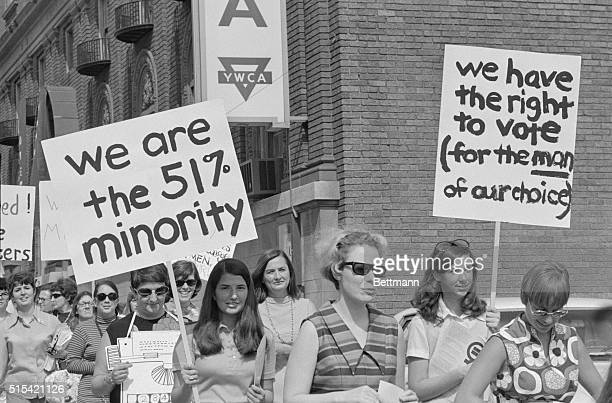 Signs of the times are shown here as about 150 women marched through downtown St Louis and visited the Mayor's office as part of women's liberation...