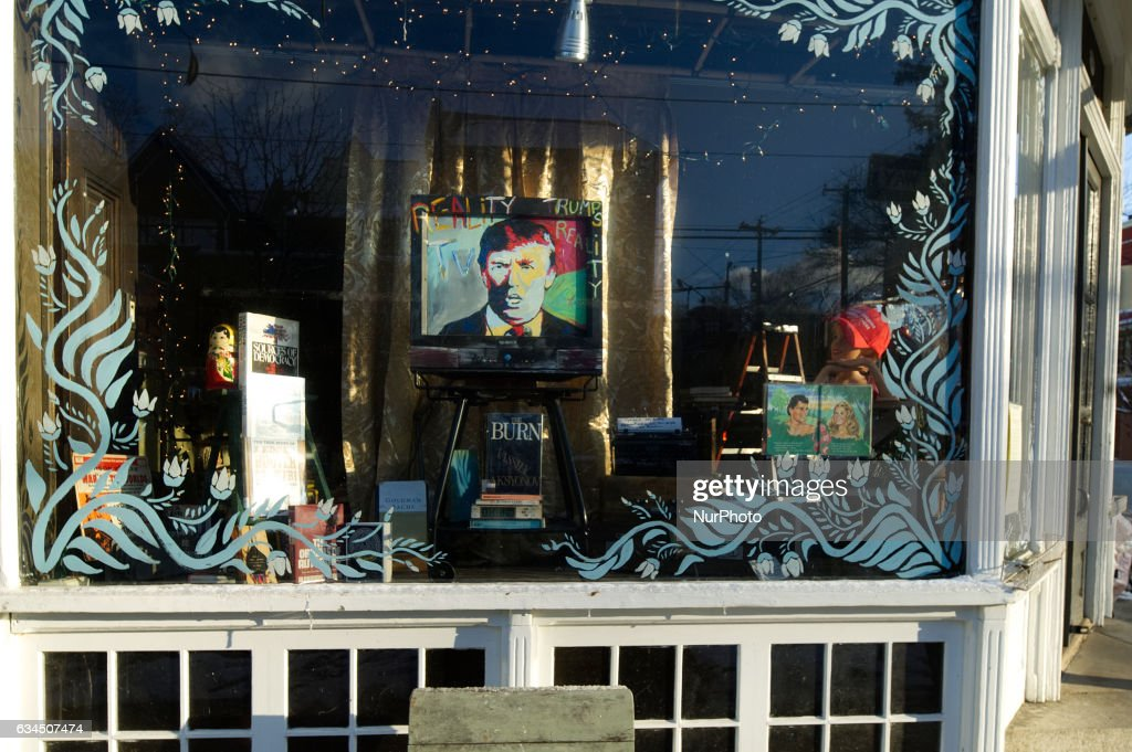 Signs of vandalism appear on the picture window of a store in the West Mount Airy section of Philadelphia, PA, on February 9th, 2017. A painted portrait of President Donald Trump is on display in the window of Moving Arts of Mount Airy . The store is located across the long time neighborhood staple CO-OP Weavers Way grocery store, which anchored the liberal and diverse Northwest Philadelphia neighborhood.