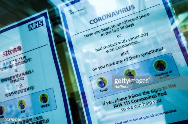 Signs offer advice regarding the covid19 coronavirus in a window at the entrance to University College Hospital which houses a 'coronavirus pod'...