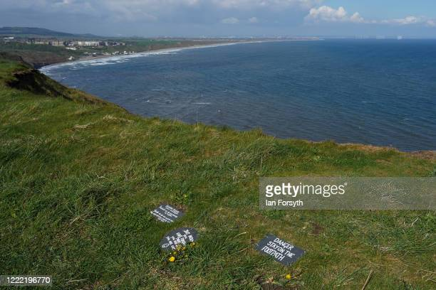 Signs offering advice reassurance and warnings are placed along a path that follows steep sea cliffs on the outskirts of Saltburn to support those...