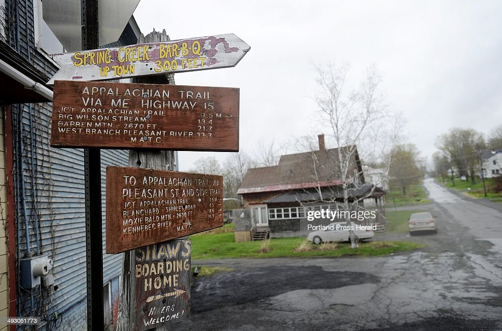 Signs on a post in downtown Monson point the way to the Appalachian Trail, boarding homes etc. Tuesday, May 8, 2012.