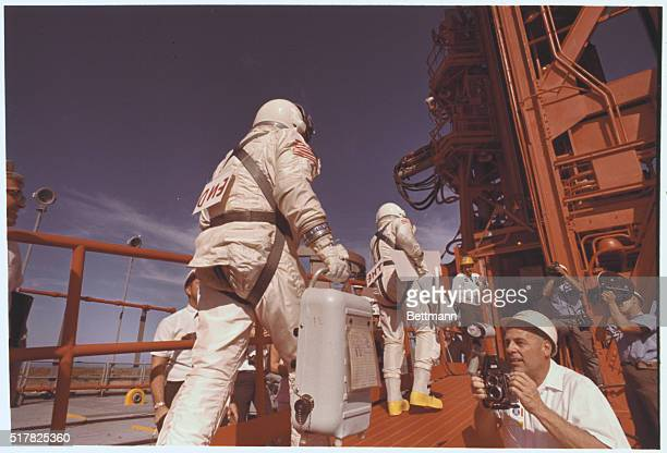 Signs on the back of astronauts Jim Lovell and Buzz Aldrin read 'The End' as they walk up gantry ramp November 11th towards the Gemini12 spacecraft...