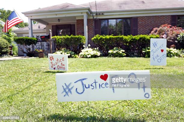 Signs on the front lawn of Lauren Wadds Wyoming Ohio home proclaim '#Justice For Otto' as the town of Wyoming prepares for the funeral of Otto...