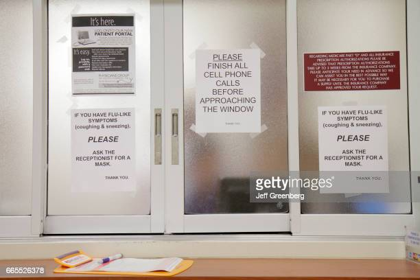 Signs on the reception windwo at Mount Sinai Medical Center