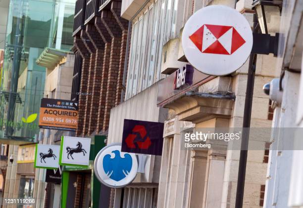 Signs outside branches of a Lloyds Banking Group Plc bank, a Barclays Bank Plc bank, a NatWest Group Plc bank, and a HSBC Holdings Plc bank in...