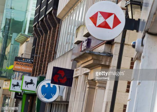 Signs outside branches of a Lloyds Banking Group Plc bank, a Barclays Bank Plc bank, a NatWest Group Plc bank and a HSBC Holdings Plc bank in...