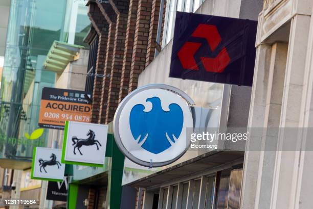 Signs outside branches of a Lloyds Banking Group Plc bank, a Barclays Bank Plc bank, a NatWest Group Plc bank in Staines, U.K., on Friday, Feb. 12,...