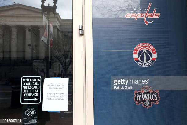 Signs outside read that the NHL Season has been suspended after the Detroit Red Wings against the Washington Capitals game was postponed due to the...