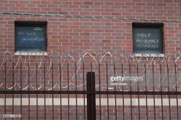 Signs pleading for help hang in windows at the Cook County jail complex on April 09, 2020 in Chicago, Illinois. With nearly 400 cases of COVID-19...