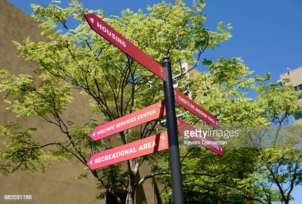 Signs point in multiple directions on the campus of University of California at Los Angeles that would be used as the Athletes Village during media...