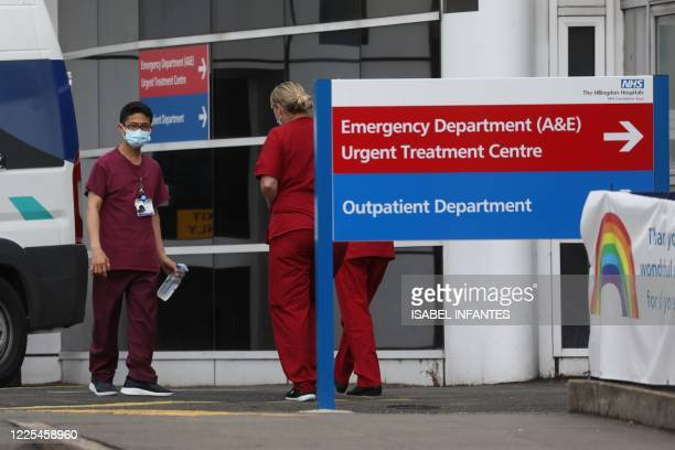 Signs point the way at Hillingdon hospital in west London on July 8, 2020. - The hospital in British Prime Minister Boris Johnson's west London...