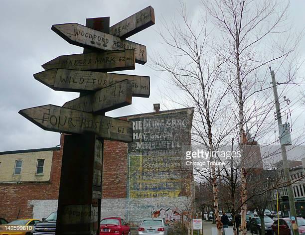 Signs point the way on East Market Street in the NuLu neighborhood of Louisville Kentucky