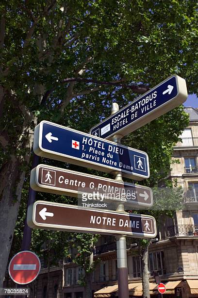 signs pointing to tourist sites, paris - centre pompidou stock pictures, royalty-free photos & images