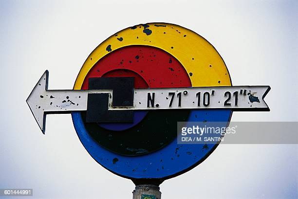 Signs pointing towards the North Cape and bearing its coordinates Mageroya island Finnmark county Norway