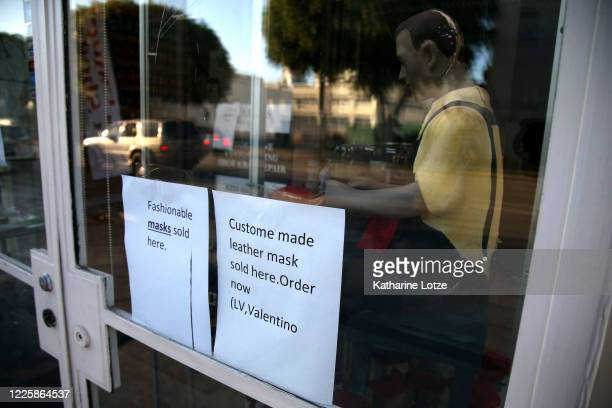 Signs posted on a business advertise face masks for sale on May 11 2020 in Westwood California The United States has reported more than 15 million...