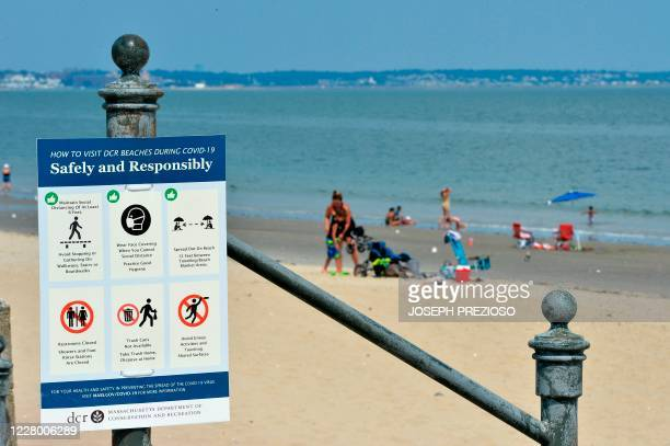 Signs promote Covid-19 safety at Revere Beach in Revere, Massachusetts on August 11, 2020. - Revere like other metro cities in the state has seen...