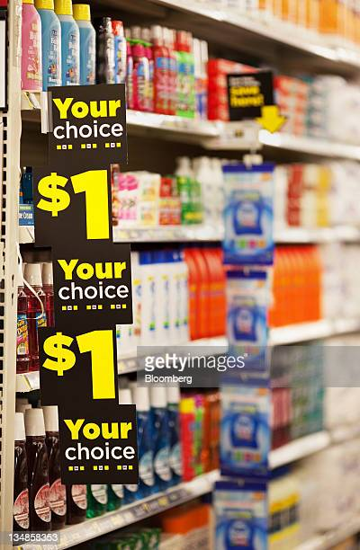 Signs promote onedollar products on the shelves of a Dollar General Corp store in Saddle Brook New Jersey US on Saturday Dec 3 2011 Dollar General is...