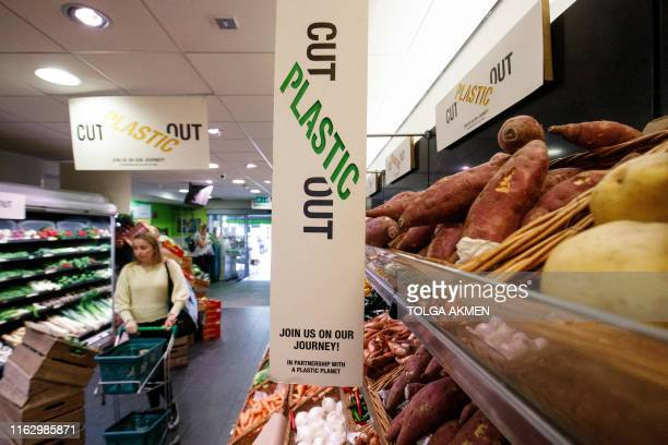 Signs promoting plastic free products and packaging are seen at Budgens supermarket in Belsize Park, north London on July 2, 2019. - British...