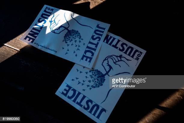 Signs reading 'Justice for Justine' lie on a park table during a demonstration on July 20 2017 in Minneapolis Minnesota Several days of...