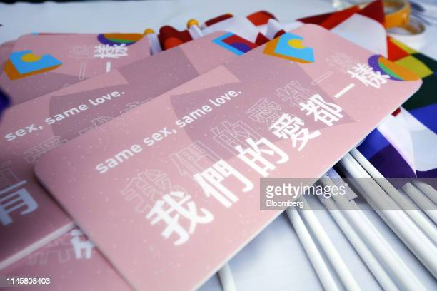 """Signs reading """"Same Sex, Same Love"""" are displayed on a table during a pro same-sex marriage party organized by the Taipei City government and..."""