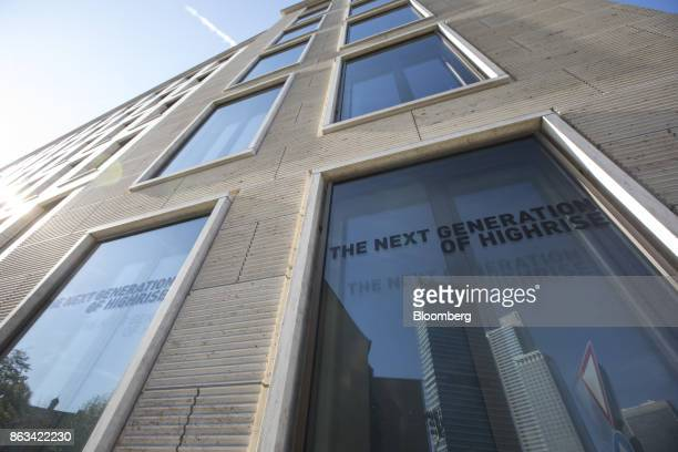 Signs reading 'the next generation of highrise' sit on lower floor windows of skyscraper Tower 185 in Frankfurt, Germany, on Wednesday, Oct. 18....