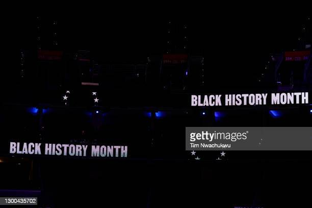 Signs referencing Black History Month are seen between the Philadelphia 76ers and the Portland Trail Blazers at Wells Fargo Center on February 04,...