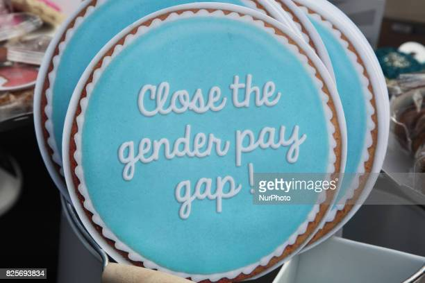 Signs saying 'close the gender pay gap' during a rally to demand equal pay for women and an end to the wage gap between the sexes on 'Equal Pay Day'...