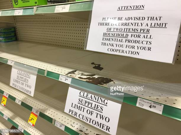 Signs seen on an empty shelf in a grocery store as stores begin limiting the amount of items people can purchase as panic buying and hoarding of food...