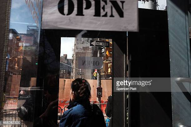 Signs show that businesses's are open near where three buildings collapsed and killed two men in the East Village last week on April 1 2015 in New...