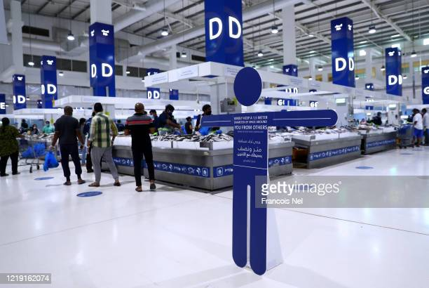 A signs showing social distancing regulations are seen the Waterfront Market on April 16 2020 in Dubai United Arab Emirates The Coronavirus pandemic...