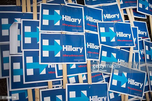 Signs showing support for Democratic presidential candidate former Secretary of State Hillary Clinton are piled on the lawn outside the University of...