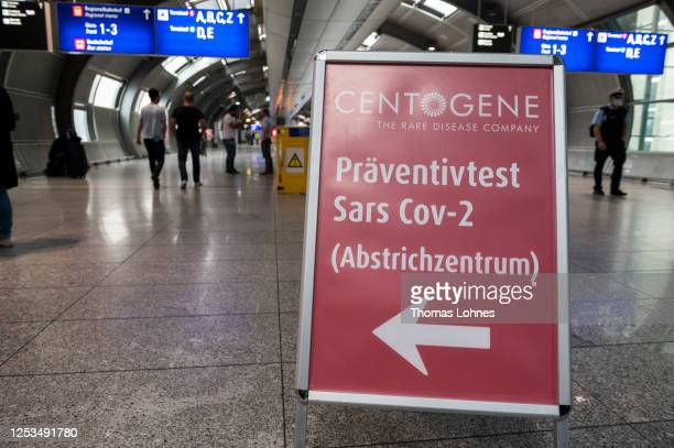 Signs shows the way to an on-site Covid-19 testing and analysis station of Contogene, a medical testing company, set up for travellers at Frankfurt...