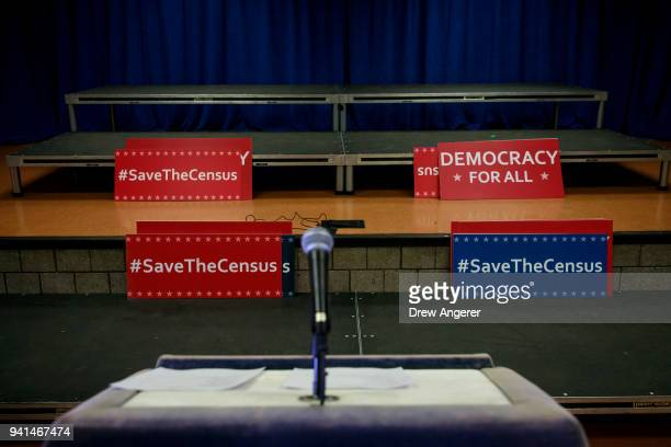 Signs sit behind the podium before the start of a press conference with New York Attorney General Eric Schneiderman to announce a multistate lawsuit...