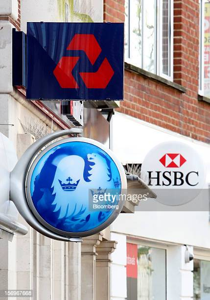 Signs sit outside branches of a Barclays Bank Plc bank a NatWest bank part of the Royal Bank of Scotland Group Plc and a HSBC Holdings Plc bank in...
