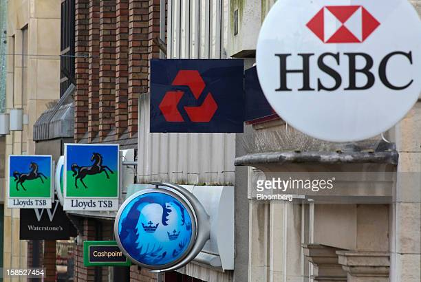 Signs sit outside branches of a Lloyds TSB bank part of the Lloyds Banking Group Plc a Barclays Plc bank a NatWest bank part of the Royal Bank of...