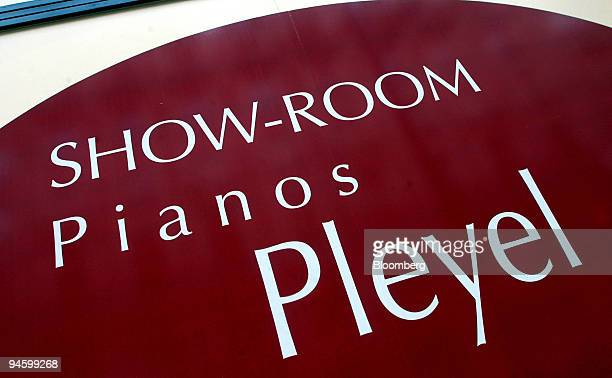 Signs sit outside the new Pleyel Pianos showroom in Paris France on Monday Oct 8 2007 Pleyel Pianos founded in Paris by Austrian composer Ignaz...