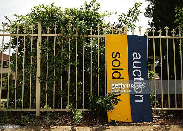 Signs stand against a fence before the home auction for a fourbedroom house at 230 Blacktown Road on February 14 2015 in Blacktown Australia The...