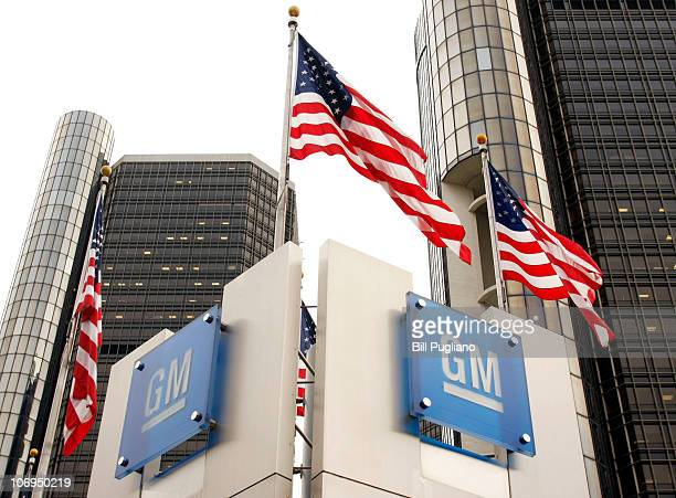 Signs stand in front of the General Motors world headquarters complex November 18 2010 in Detroit Michigan GM returned to selling its newly issued...