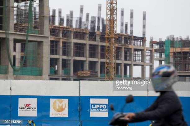 Signs stand on protective hoardings surrounding the under construction Meikarta project developed by Lippo Group in Bekasi Regency West Java Province...