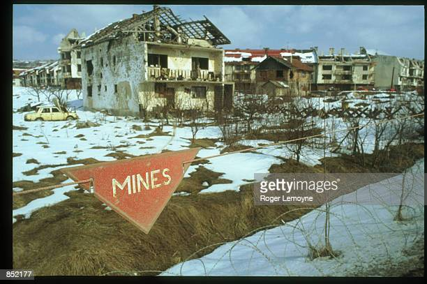 Signs stands in front of destroyed buildings March 5, 1996 in Sarajevo, Bosnia-Herzegovina. The city is reopening its businesses, repairing damages...