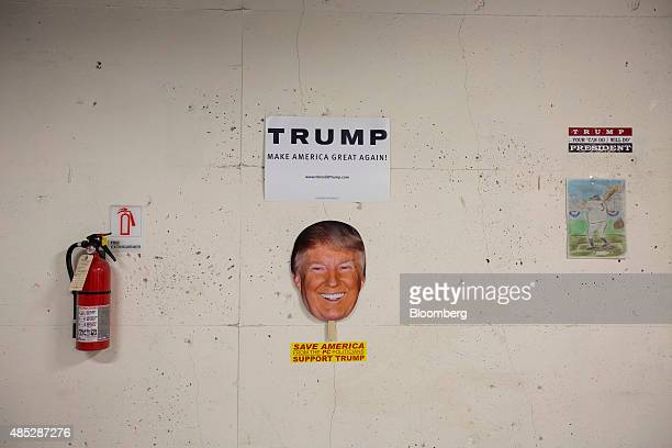 Signs supporting Donald Trump president and chief executive of Trump Organization Inc and 2016 Republican presidential candidate hang on a wall at...
