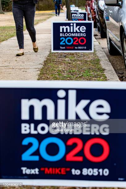 Signs supporting former New York City Mayor Michael Bloombergs campaign for the Democratic presidential nomination line the sidewalk outside of...
