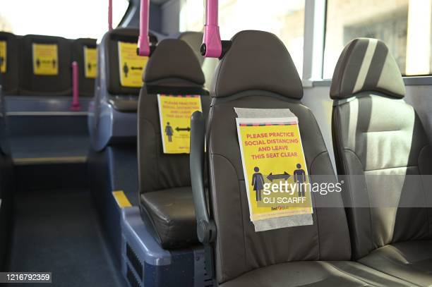 Signs taped to the seats of a bus facilitate social distancing in Leeds northern England on June 1 2020 following the easing of the lockdown...