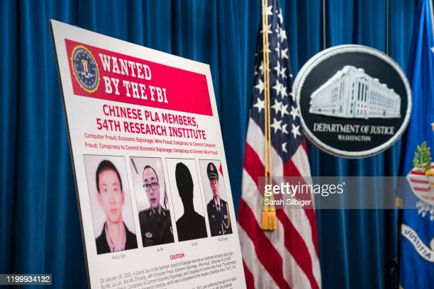 Signs that depict the four members of China's military indicted on charges of hacking into Equifax Inc and stealing data from millions of Americans...