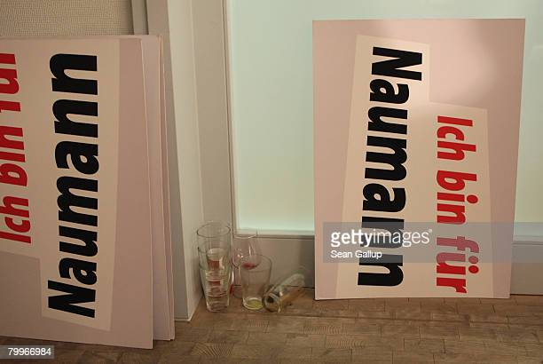 Signs that read I'm for Naumann lie next to empty glasses at the headquarters of the Hamburg German Social Democrats after local state parliamentary...