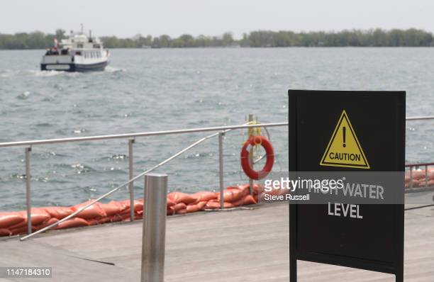 TORONTO ON MAY 31 Signs warn of high water at Queens Quay Terminal as the High water levels in Lake Ontario have portions of Toronto's waterfront...
