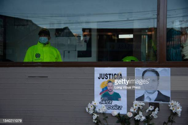 Signs with photos of Javier Ordonez and flowers as the Villa Luz CAI police station were police officers tortured Javier Ordonez on September 9 later...