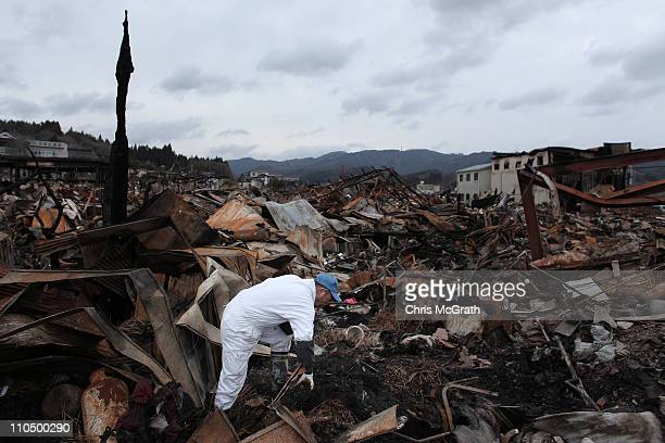 Sigo Hatareyama works to clean out what is left of his house on March 21 2011 in Kesennuma Japan The 90 magnitude strong earthquake struck offshore...