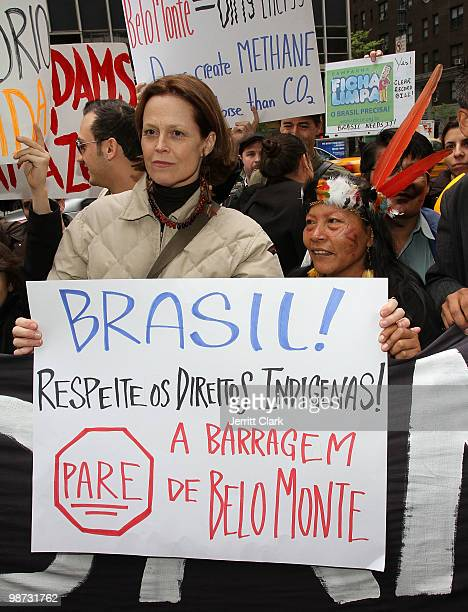 Sigourney Weaver and Manuela Omari Ima Omene of the Huaorani protest the construction of the Belo Monte Dam in Brazil in front of the Brazilian...