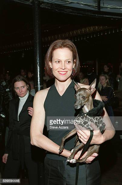 Sigourney Weaver presents a dog with a 'fur' coat